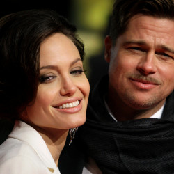 "Actors Brad Pitt and Angelina Jolie pose for photographers on the red carpet at the German premiere of the movie ""The Curious Case of Benjamin Button"" in Berlin on Jan. 19, 2009."