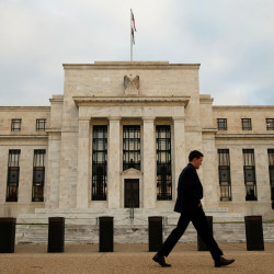 A man walks past the Federal Reserve in Washington, Dec. 16, 2015.