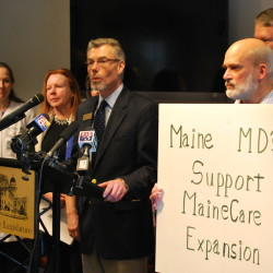 Andrew MacLean, deputy executive vice president of the Maine Medical Association, voices his organization's support for Medicaid expansion at the State House Welcome Center in Augusta, Jan 23, 2014.