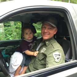 Warden Jim Fahey with a toddler reported missing in Bradford on Monday. The boy was found sleeping in a tire rut.