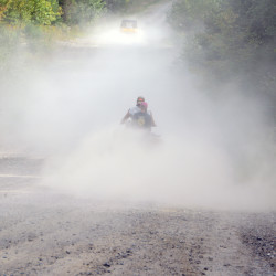 Two ATVs disappear down Half Township Road in Lincoln. Millinocket volunteers hope to forge the first connection between the networked ATV trails of southern and northern Maine.