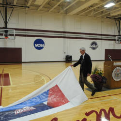 Former longtime University of Maine-Farmington coach and teacher Len MacPhee unveils the newly painted basketball court at Dearborn Gym that has been named Len MacPhee Court in his honor. A ceremony was held at the facility last Friday.