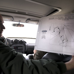 Wind farm developer Paul Fuller shows a site map of the Pisgah Mountain wind project during a tour of the site in Clifton in this March 2016 file photo.