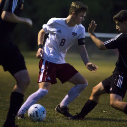 Carson Atherley of Bangor High School (middle), pictured during a Sept. 7 game against Brewer, scored a goal Tuesday night to help the Rams knock off previously unbeaten Camden Hills 2-0.