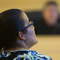 Case manager Heather MacKenzie listens to a defendant's story during the first opening session of the Penobscot County Adult Drug Treatment Court Wednesday at the Penobscot Judicial Center in Bangor.
