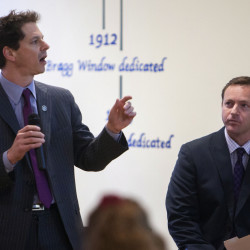 Sen. Justin Alfond (left) and Speaker of the House Mark Eves give a presentation on the Democrats' budget proposal during a town hall meeting at the Hammond Street Congregational Church in Bangor in this April 2015 file photo.