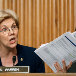 Sen. Elizabeth Warren, D-Massachusetts, shows company documents to Wells Fargo CEO John Stumpf during his testimony before a Senate Banking Committee hearing on the firm's sales practices on Capitol Hill in Washington, Sept. 20, 2016.