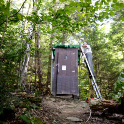 Craig Dickstein, a trail maintainer for the Maine Appalachian Trail Club, tears down the old outhouse along the AT at the base of Pleasant Pond Mountain as part of a privy replacement project. The plan to replace all 42 privies that the MATC maintains along the AT in Maine, began in 2013. The old pit-style privies are being replaced with new, more sustainable and environmentally friendly privies.