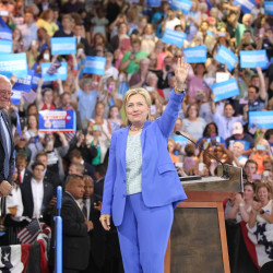 Hillary Clinton greets the crowd along with Sen. Bernie Sanders during an event in which she was endorsed by Sanders at Portsmouth High School on Tuesday, July 12, 2016 in Portsmouth, New Hampshire.