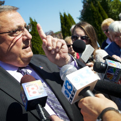 Gov. Paul LePage speaks to reporters in Scarborough in 2014.