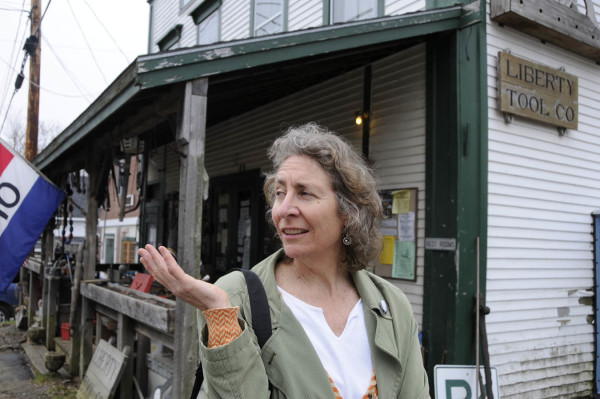 Artist Martha Piscuskas of Liberty talks about the collaboration with her fellow townfolk on her interactive paper sculpture project &quotDearly Kept.&quot The exhibit pieces are interspersed at various locations in Liberty. (BDN photo by John Clarke Russ)
