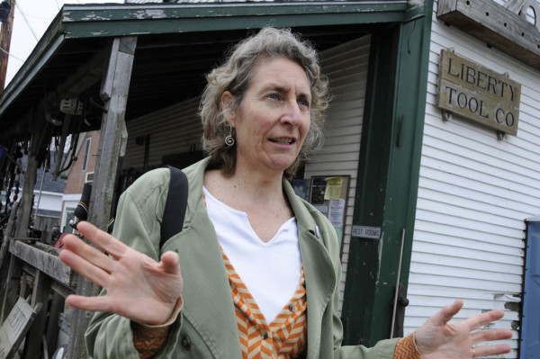 Artist Martha Piscuskas of Liberty talks about the collaboration with her fellow townfolk on her interactive paper sculpture project &quotDearly Kept.&quot The exhibit's pieces are interspersed at various locations in Liberty. (BDN photo by John Clarke Russ)