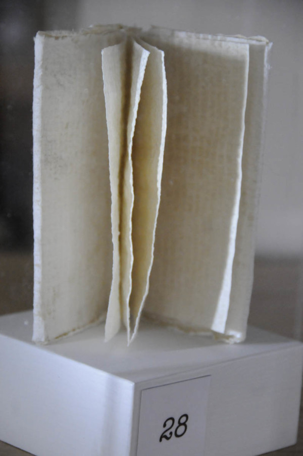 This paper sculpture by Liberty artist Martha Piscuskas assumes the form of a small book but, like her other exhibit pieces, is meant to elicit different responses. It is on display at the Ivan O Davis Library in Liberty, ME and is part of her interactive paper sculpture project &quotDearly Kept.&quot The exhibit pieces are interspersed at various locations in Liberty. (BDN photo by John Clarke Russ)