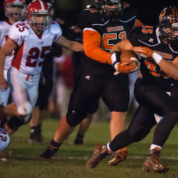 Trey Wood of Brewer High School (right) runs for a big gain during a 2015 game against Cony. The Witches face Skowhegan on Friday at Doyle Field in a battle of Class B North unbeatens.