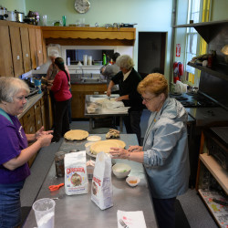 Members of the Women's Society for Christian Service make pies on Sept. 16 in the kitchen of the Franklin Street United Methodist Church in Bucksport. The ladies will sell their pies at their weekly bake sale.