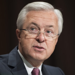 Wells Fargo CEO John Stumpf testifies about the company opening unauthorized accounts under customers' names at a Senate Banking, Housing and Urban Affairs hearing on Tuesday.