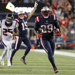 New England Patriots running back LeGarrette Blount (29) runs past Houston Texans cornerback Kareem Jackson (25) for a touchdown during the second half at Gillette Stadium in Foxborough, Mass., Thursday  night.