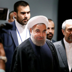 Iranian President Hassan Rouhani smiles as he arrives at a news conference near the United Nations General Assembly in the Manhattan borough of New York, Sept. 22, 2016.