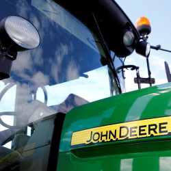 A logo of John Deere is seen on a tractor at the international agriculture exhibition in Minsk, Belarus, June 7, 2016.