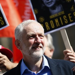 Jeremy Corbyn, the leader of Britain's opposition Labor Party joins a protest by campaigners calling for an inquiry into a confrontation between police and pickets in Orgreave in 1984, outside Parliament, in London, Sept. 13, 2016.