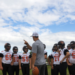 Brewer High football coach Nick Arthers goes over a play with his team during practice in this August 2015 file photo.