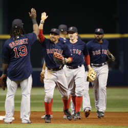 Boston Red Sox right fielder Mookie Betts (50), first baseman Hanley Ramirez (13) and teammates congratulate each other after they beat the Tampa Bay Rays at Tropicana Field in St. Petersburg, Florida, Friday night.