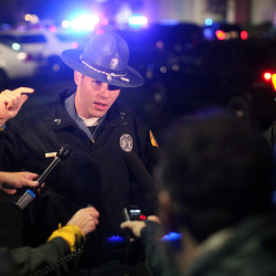 Washington State Trooper Mark Francis speaks to the media at the Cascade Mall following reports of an active shooter in Burlington, Washington, Sept. 23, 2016.
