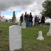 Civil War re-enactors gather behind the new monument of Army Pvt. Jewett Williams in the Hodgdon Cemetery Saturday afternoon.