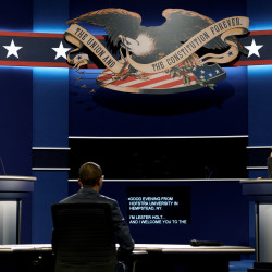 Hostra University students playing the roles of Donald Trump and Hillary Clinton and moderator go through a rehearsal for the first presidential debate at Hofstra University in Hempstead, New York, Sept. 25, 2016.