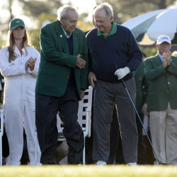 Arnold Palmer (left) shakes hands with Jack Nicklaus during the first round of the 2016 The Masters golf tournament at Augusta National Golf Club.