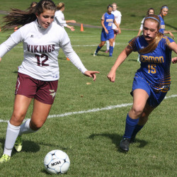 Caribou's Gabrielle Marquis dribbles the ball up the field while Hermon's Emily Smith defends during Saturday's soccer match played at Caribou High School. The Hawks stopped the Vikings, 3-1.