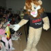 Daren the lion asks for a high-five at a D.A.R.E. graduation ceremony.