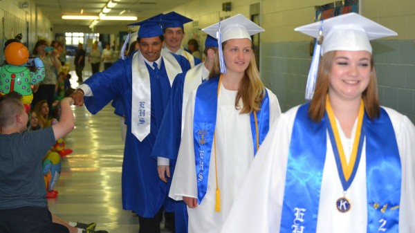 Easton High School graduating seniors in June walked the elementary school halls and received well wishes from students and staff members. From front to back are Macey Currier, Emma Bonner, Brandon Hosford (obscured), Jason Gurley and Logan Halvorson.