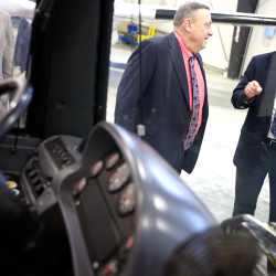 Hugh Corbett, executive director of the Maine Military Authority, shows Gov. Paul LePage a fixed-route transit bus refurbished by the company on Jan. 16, 2014, in Augusta.