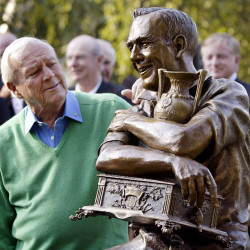 Golf legend Arnold Palmer (left) looks at a statue of himself commemorating the 50th anniversary of his first PGA tour win in 1955 at the Weston Golf and Country Club in Toronto Sept. 13, 2005.