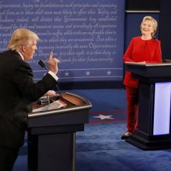 Republican U.S. presidential nominee Donald Trump speaks as Democratic U.S. presidential nominee Hillary Clinton listens during their first presidential debate at Hofstra University in Hempstead, New York.