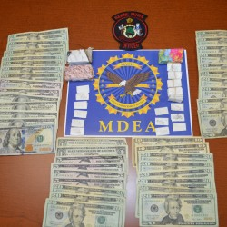 An estimated $8,000 in heroin and $1,100 in cash were seized as the result of a traffic stop by Maine Marine Patrol officers on Friday. Two Trenton residents and a Connecticut man are facing drug charges in connection with the seizure.