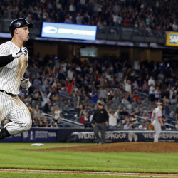 New York Yankees first baseman Tyler Austin rounds first base after hitting a two-run home run off of Boston Red Sox starting pitcher David Price (background) during the seventh inning at Yankee Stadium in New  York Tuesday night.