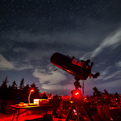 Hundreds gathered over the course of Saturday evening for the Star Party on Cadillac Mountain as part of the Acadia Night Sky Festival in Bar Harbor. Volunteer astronomers and park rangers were present to describe constellations and other night sky features visible with the naked eye, binoculars and telescopes. Visitors were encouraged to use red night vision flashlights and cover standard white lights and cellphones with red cellophane to preserve nighttime vision.