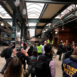 Onlookers view a New Jersey Transit train that derailed and crashed through the station in Hoboken, New Jersey, Sept. 29, 2016.