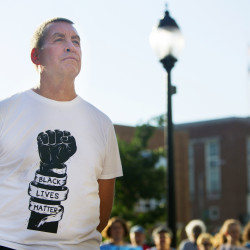 "A Bangor-area resident wears a ""Black Lives Matter"" T-shirt during a vigil on July 13, 2016, in honor of Alton Sterling and Philando Castile, two black men killed by police in Baton Rouge and Minneapolis, and police officers killed at a peaceful Black Lives Matter protest in Dallas."