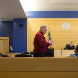 Bruce Campbell of Wellspring in Bangor (center) addresses the defendants during the first opening session of the Penobscot County Adult Drug Treatment Court on Sept. 21 at the Penobscot Judicial Center in Bangor.