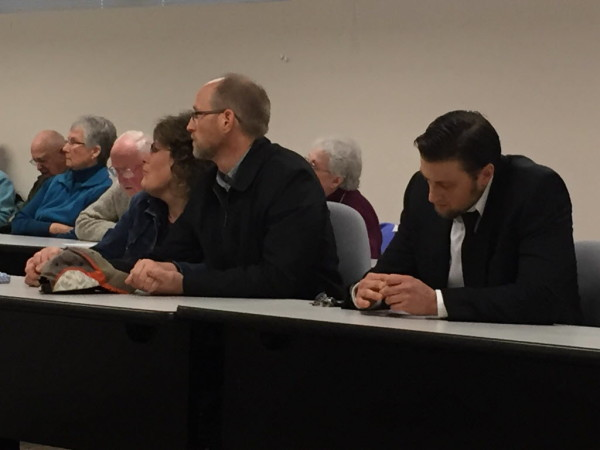 Nathan Beck (right) and his father, Dan Beck (center), listen during a Human Rights Commission hearing regarding allegations that Moody's Diner, which is co-owned by Beck, discriminated against a longtime employee in Augusta in this November 2014 file photo.