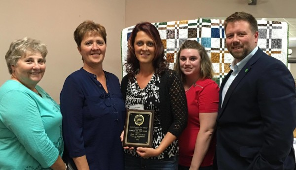 Amy Ouellette, MTCMA Rookie of the Year at Center is joined from L-R by her mother in law, Joan, mother Karen, Deputy Clerk Nathalie Morneault and Town Manager Ryan Pelletier at the 21st Annual Clerk Networking Day held in Waterville.