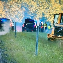 Two people are in custody after they allegedly drove a front loader the wrong way in the northbound lanes of the Maine Turnpike Monday morning, according to police.