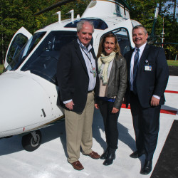 Blue Hill Memorial Hospital unveiled its new helipad to the public on September 29, 2016. John Ronan, president and CEO of BHMH (on right), along with Thomas Judge, LifeFlight of Maine's executive director (on left), and Amy Root, director of development for LifeFlight Foundation (center), stand in front of one of LifeFlight's helicopters after it touched down on the new helipad behind the hospital.