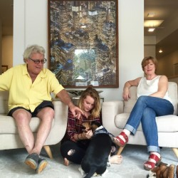 Artist Charlie Hewitt, his wife Kate Carey and daughter Ruby play with their pups in their new sleek, art-filled home, formerly Goff's Hardware in downtown Yarmouth.