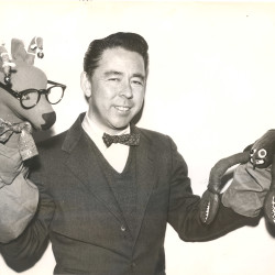 Francis Hamabe and two of his puppets.