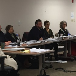 Members of the Maine Human Rights Commission listen to testimony Nov. 17, 2014, during a hearing about religious discrimination accusations filed against Moody's Diner by an employee.