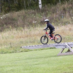 A rider manuvers the teeter-totter at the Four Seasons Trails on Sunday.